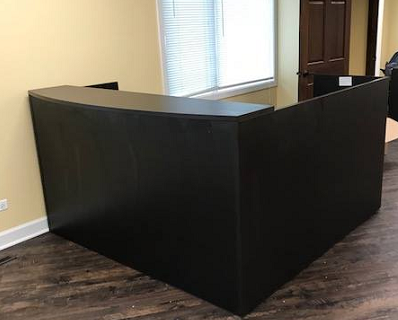 Black reception desk with shell in Milwaukee office