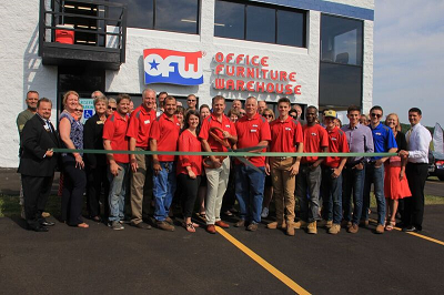 Waukesha Office Furniture Warehouse employees at ribbon cutting ceremony for open house celebration