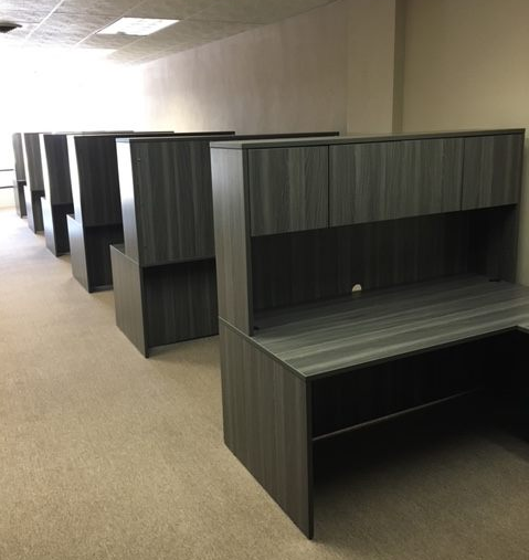 Grey wood vener workstations in a row inside a Kenosha office building