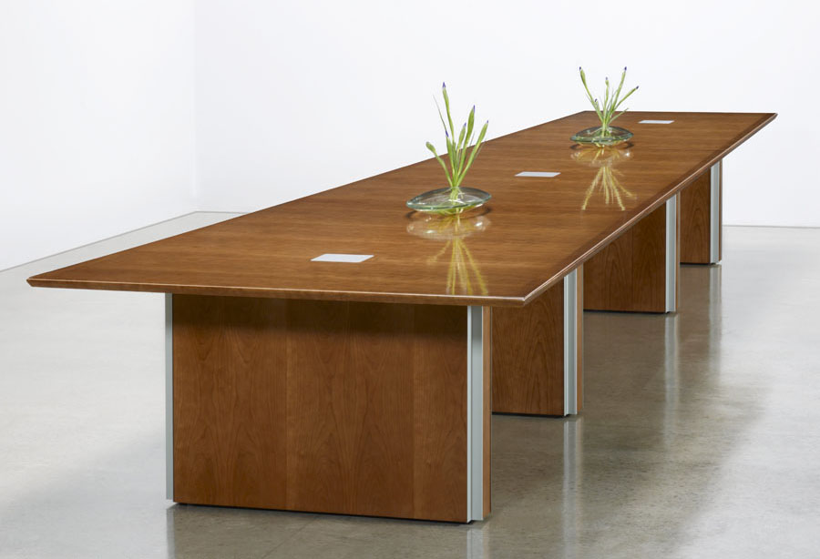Custom transitional conference table with 3 panel base and metal inlays