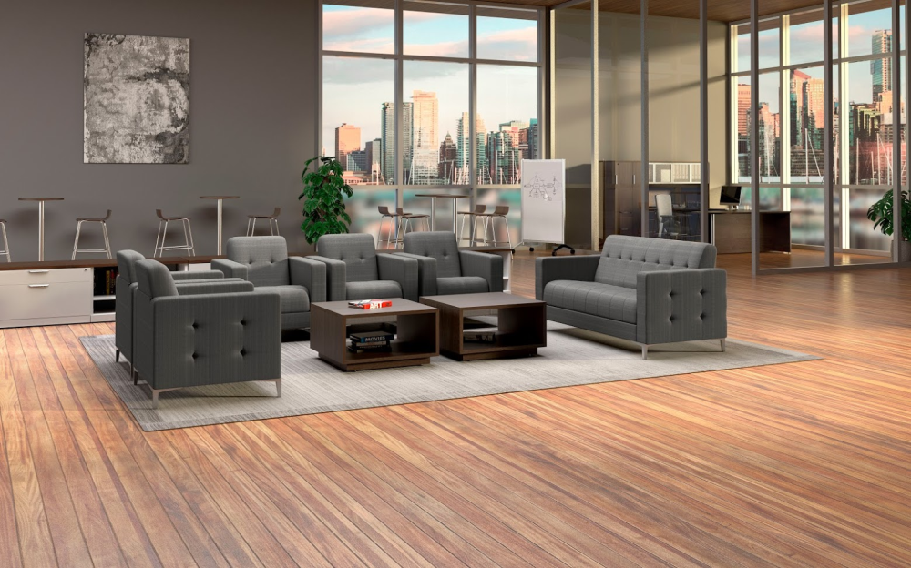 Modern office lounge with 5 grey fabric lounge chairs and a matching sofa