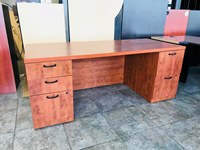 Wooden desk with filing drawers and black handles for office or home use