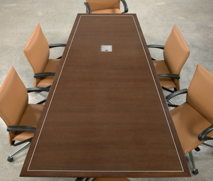 Top view of rectangular wood veneer 10 foot conference table with metal inlay detail and data port