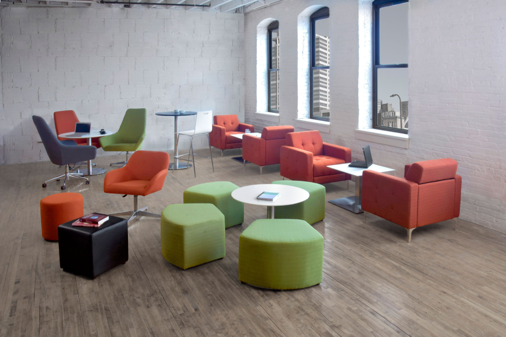 Modern office break room with lounge seating in burnt orange and lime green