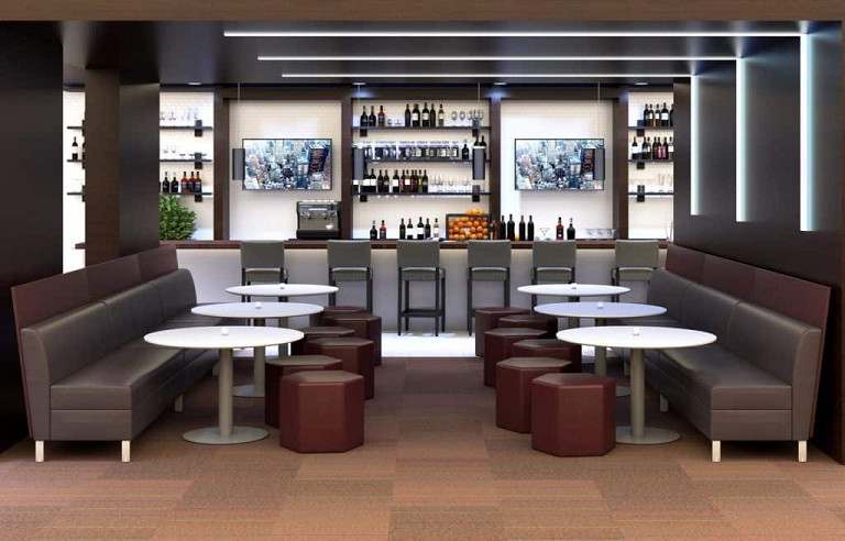 Modern lounge furniture in a bar including sofas, ottomans and tables