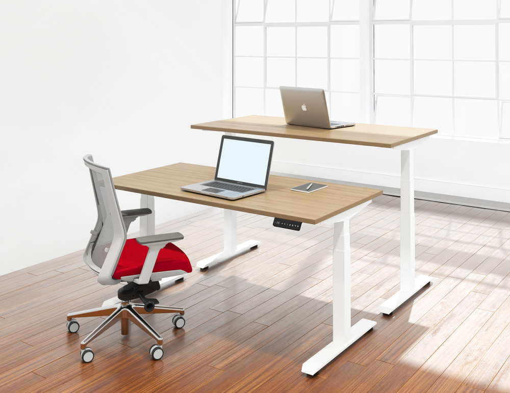 Sit stand office desks with white legs and wood surfaces in modern office