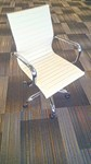 Used white leather office chair with wheels - front view