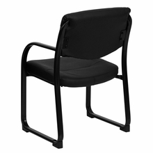 Cushioned black leather reception chair with open back and black frame