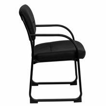 Black reception chair with open back curved arms and black frame