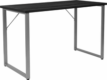Rectangular black desk with silver metal frame and floor glides