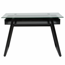Black computer desk with glass surfacing and angled legs