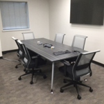 8 foot wood veneer grey conference table and chairs in Milwaukee meeting room