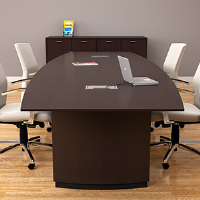 8 foot conference room table in dark wood veneer with five white meeting room chairs