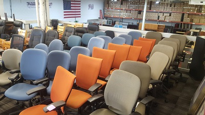 used office chairs in blue fabric, orange fabric, beige fabric and black leather